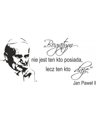 napis na ścianę  Jana Pawla ll Bogatym nie jest ten co posiada